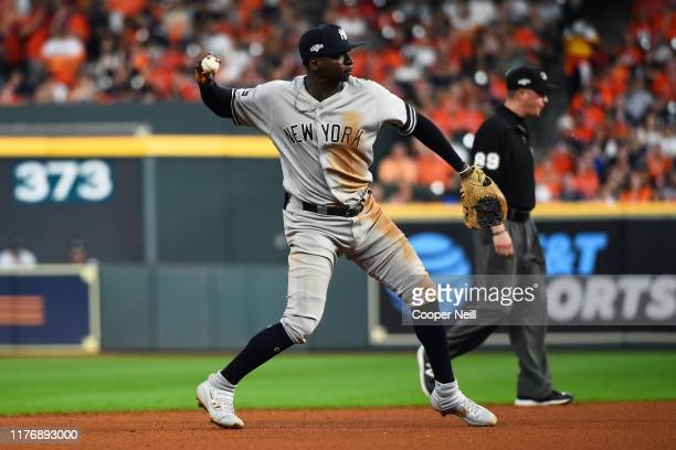 Didi Gregorius of the New York Yankees makes a throw to first during Game 6 of the ALCS between the New York Yankees and the Houston Astros at Minute...