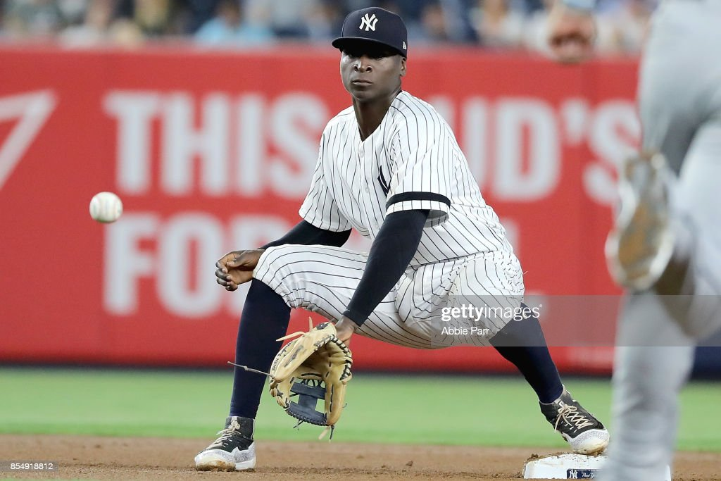 Didi Gregorius #18 of the New York Yankees prepares to tag a runner out at second in the seventh inning against the Tampa Bay Rays at Yankee Stadium on September 27, 2017 in the Bronx borough of New York City.