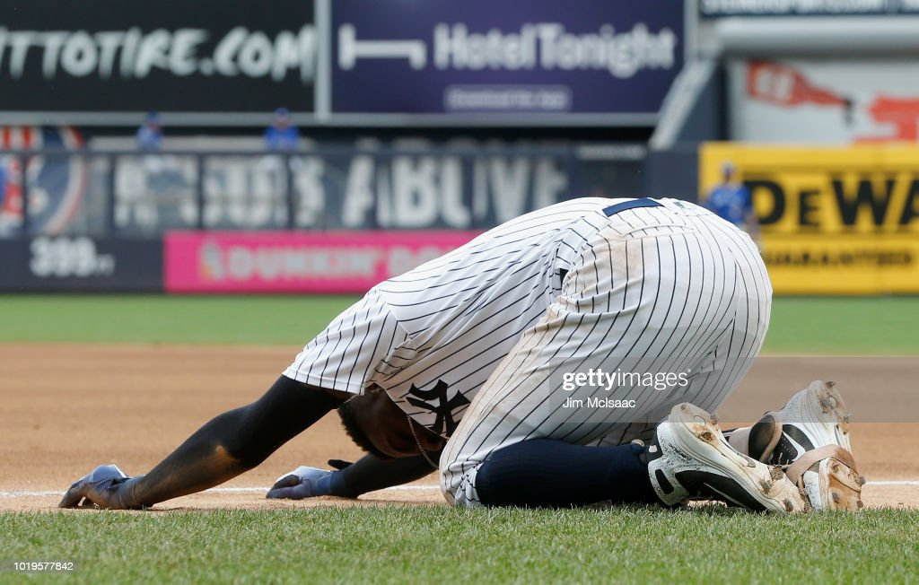 Didi Gregorius #18 of the New York Yankees reacts after a collision at first base in the first inning against the Toronto Blue Jays at Yankee Stadium on August 19, 2018 in the Bronx borough of New York City.