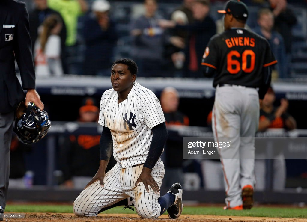 Didi Gregorius #18 of the New York Yankees reacts after being tagged out at home plate by Mychal Givens #60 of the Baltimore Orioles during the eleventh inning at Yankee Stadium on April 6, 2018 in the Bronx borough of New York City.