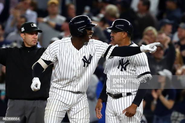Didi Gregorius of the New York Yankees reacts after hitting a single scoring Aaron Judge during the fifth inning against the Houston Astros in Game...