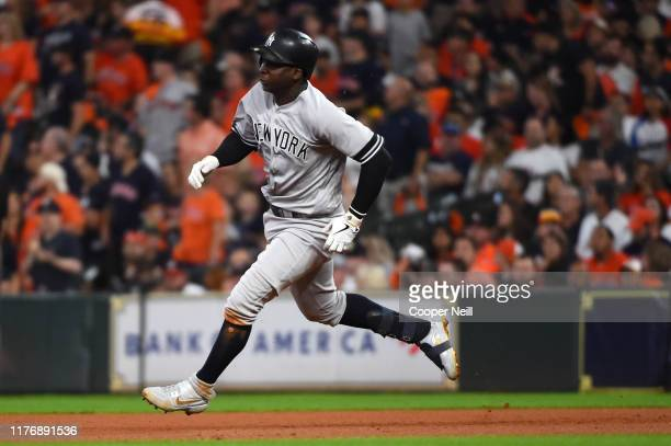 Didi Gregorius of the New York Yankees runs along the baseline after hitting a double during the second inning of Game 6 of the ALCS between the New...