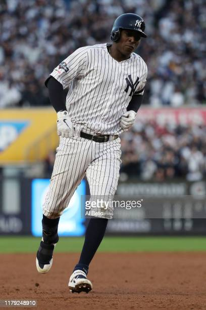 Didi Gregorius of the New York Yankees runs the bases after his grand slam home run off Tyler Duffey of the Minnesota Twins in the third inning in...