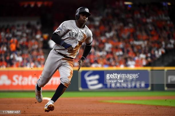 Didi Gregorius of the New York Yankees runs the bases to score on a single hit by Gary Sanchez during the second inning of Game 6 of the ALCS between...