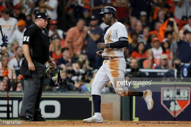 Didi Gregorius of the New York Yankees scores a run against the Houston Astros during the second inning in game six of the American League...