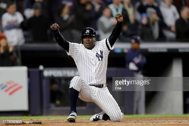 Didi Gregorius of the New York Yankees scores a run off of a double hits a by DJ LeMahieu against the Minnesota Twins during the seventh inning in...