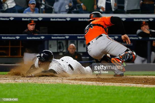 Didi Gregorius of the New York Yankees scores the game winning run on Aaron Hicks RBI double in the eleventh inning against the Baltimore Orioles at...