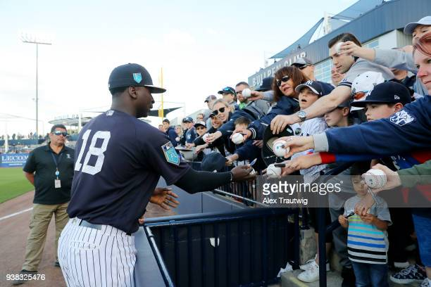 Didi Gregorius of the New York Yankees signs autographs before a game against the Baltimore Orioles on Wednesday March 21 2018 at George M...
