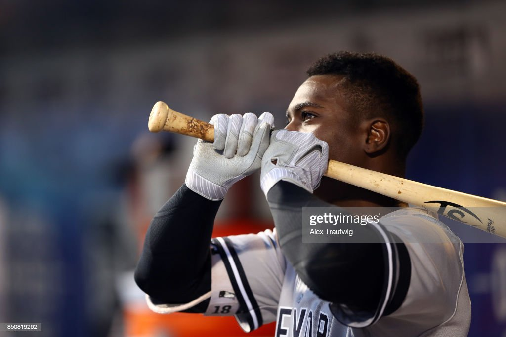 Didi Gregorius #18 of the New York Yankees stands in the dugout during the game against the Tampa Bay Rays at Citi Field on Monday, September 11, 2017 in the Queens borough of New York City.