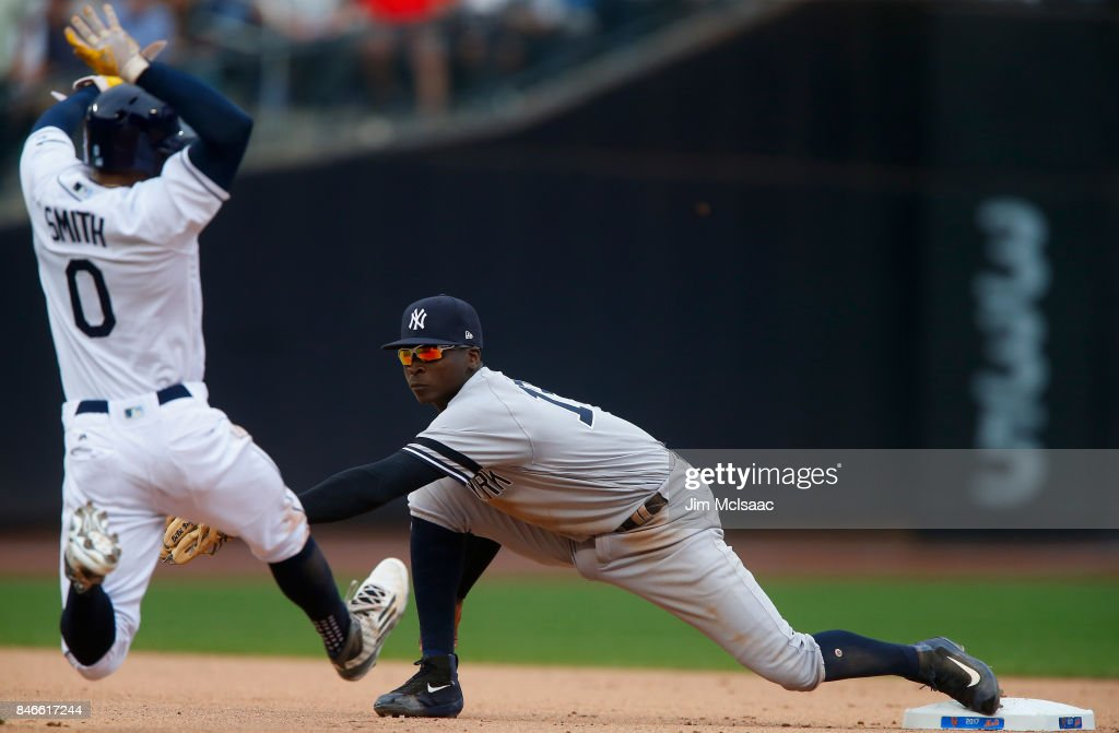 Didi Gregorius #18 of the New York Yankees stretches for a force of against Mallex Smith #0 of the Tampa Bay Rays completing a double play in the seventh inning at Citi Field on September 13, 2017 in the Flushing neighborhood of the Queens borough of New York City. The two teams were scheduled to play in St. Petersburg, Florida but due to the weather emergency caused by Hurricane Irma, the game was moved to New York, but with Tampa Bay remaining the 'home' team.
