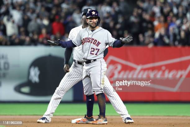 Didi Gregorius of the New York Yankees tags out Jose Altuve of the Houston Astros during the seventh inning in game five of the American League...