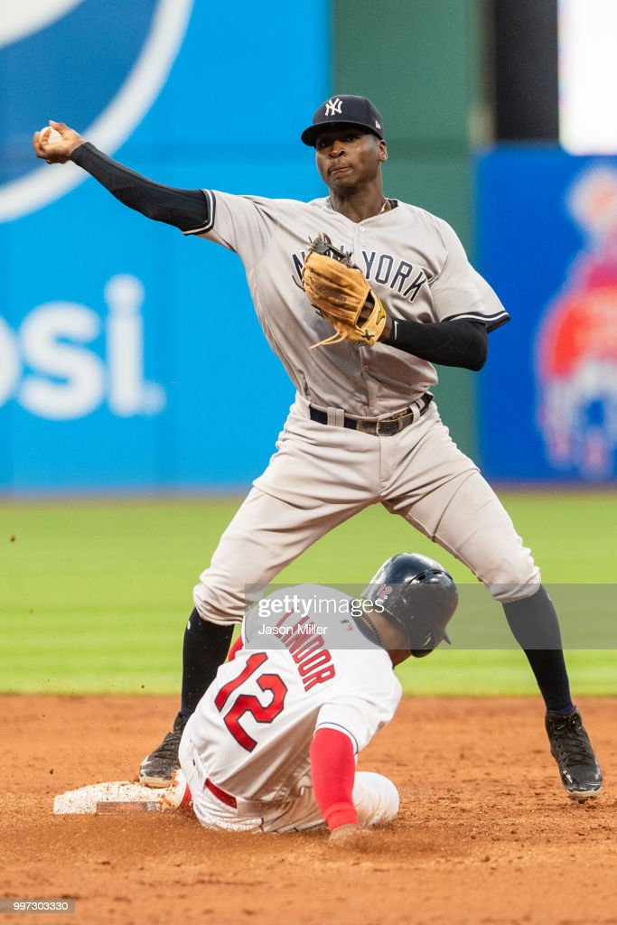 Didi Gregorius #18 of the New York Yankees throws out Michael Brantley #23 of the Cleveland Indians at first as Francisco Lindor #12 is out at second for a double play during the fifth inning at Progressive Field on July 12, 2018 in Cleveland, Ohio.
