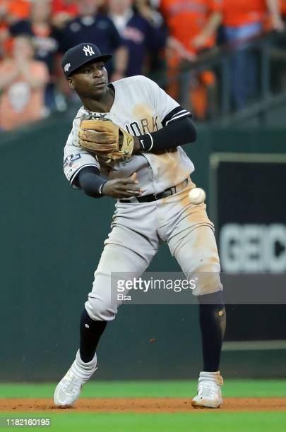 Didi Gregorius of the New York Yankees throws out the runner at second base against the Houston Astros during the sixth inning in game six of the...