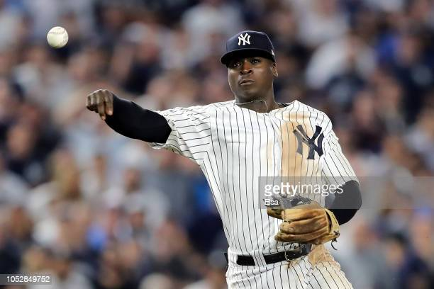 Didi Gregorius of the New York Yankees throws to first base against the Boston Red Sox during Game Four American League Division Series at Yankee...