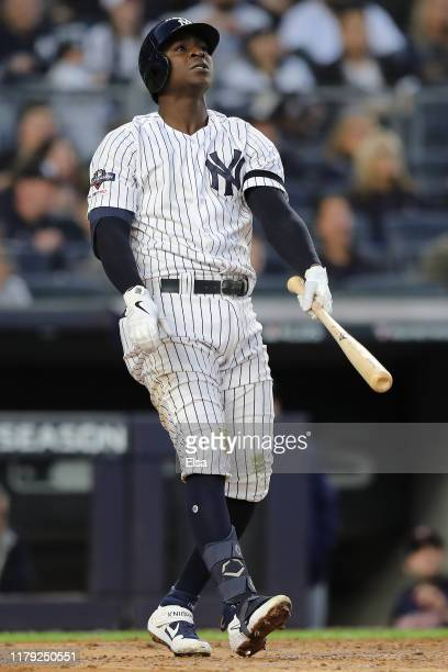 Didi Gregorius of the New York Yankees watches his grand slam home run off Tyler Duffey of the Minnesota Twins in the third inning in game two of the...