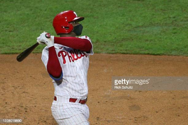 Didi Gregorius of the Philadelphia Phillies hits a sacrifice fly to score a run against the Baltimore Orioles during the third inning of an MLB...
