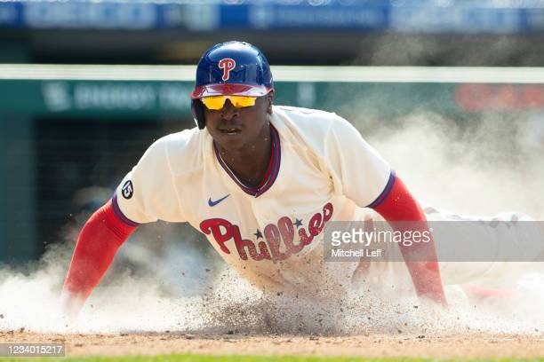 Didi Gregorius of the Philadelphia Phillies slides home safely in the bottom of the first inning against the Miami Marlins during Game One of the...