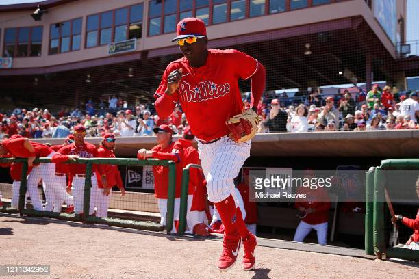 Didi Gregorius of the Philadelphia Phillies takes the field against the Boston Red Sox during a Grapefruit League spring training game on March 07...