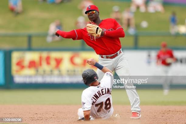 Didi Gregorius of the Philadelphia Phillies turns a double play against the Minnesota Twins in the fifth inning of a Grapefruit League spring...