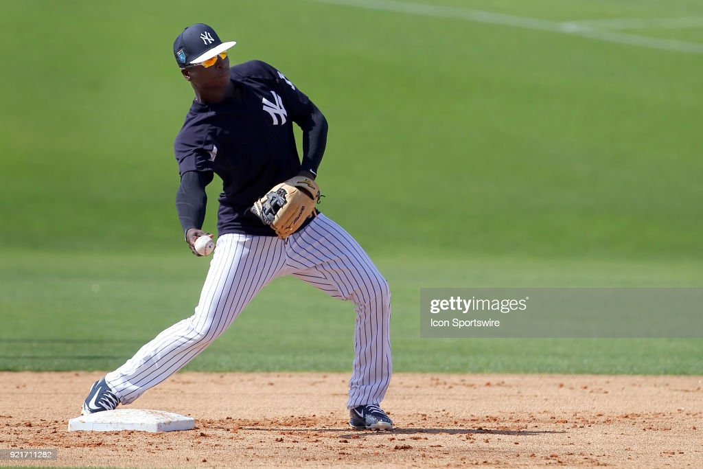 DiDi Gregorius (18) tosses the ball over to first base during the New York Yankees spring training workout on February 20, 2018, at George M. Steinbrenner Field in Tampa, FL.