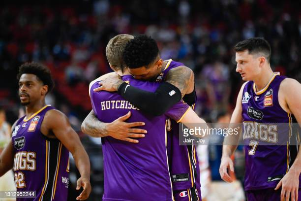Didi Louzada of Sydney Kings hugs Lochlan Hutchison of Sydney Kings after the Sydney Kings win the match during the round 14 NBL match between the...