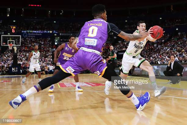 Didi Louzada of the Kings and Ben Magden of the Phoenix compete for the ball during the round 12 NBL match between the Sydney Kings and the South...