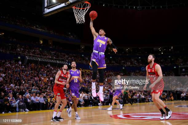 Didi Louzada of the Kings slam dunks during game one of the NBL Grand Final series between the Sydney Kings and the Perth WIldcats at Qudos Bank...