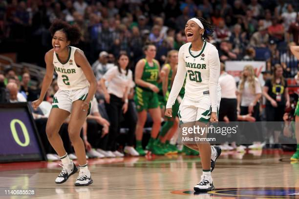 DiDi Richards and Juicy Landrum of the Baylor Lady Bears celebrate their 7267 win over the Oregon Ducks in the semifinals of the 2019 NCAA Women's...