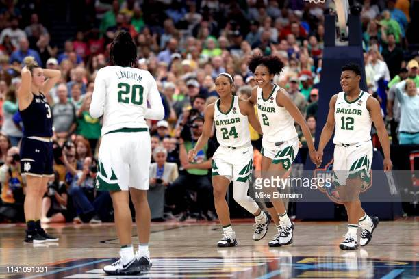 DiDi Richards Chloe Jackson Moon Ursin and Juicy Landrum of the Baylor Lady Bears celebrate their late game lead over the Notre Dame Fighting Irish...