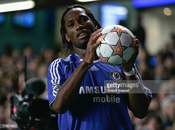 Didieer Drogba of Chelsea picks up the ball during the UEFA Champions League Group B match between Chelsea and Schalke at Stamford Bridge on October...