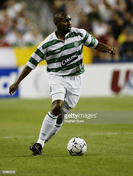 Didier Agathe of Celtic looks to pass the ball during the PreSeason match between Celtic and Manchester United on July 22 2003 at Seahawks Stadium in...