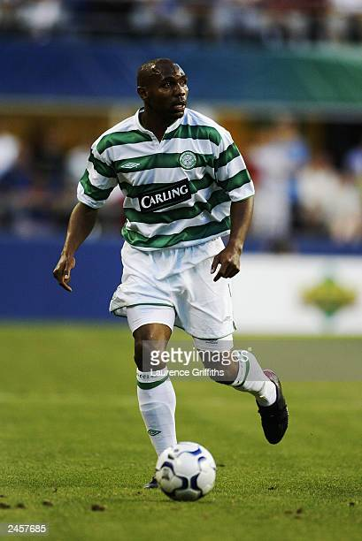 Didier Agathe of Celtic looks up to cross the ball during the Champions World Series game between Manchester United and Celtic on July 23 2003 at...