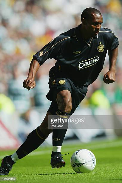 Didier Agathe of Celtic runs with the ball during the PreSeason Friendly match between Glasgow Celtic and Arsenal held on August 2 2003 at Celtic...
