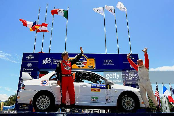 Didier Auriol and Denis Giraudet of France celebrate their third place in the singles category of the Rally of Nations Mexico 2009 on July 12 2009 in...