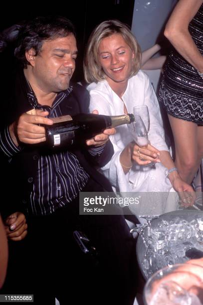 Didier Bourdon and a Girl friend during 2004 Cannes Film Festival The Lotus Party at VIP Room Club at The Palm Beach Casino in Cannes France