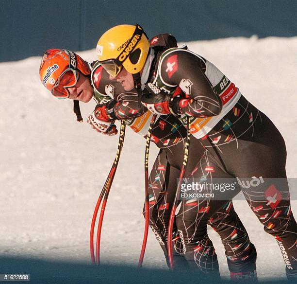 Didier Cuche and Bruno Kernen of the Swiss team confer after their downhill training run on the Birds of Prey course in Beaver Creek CO 03 February...