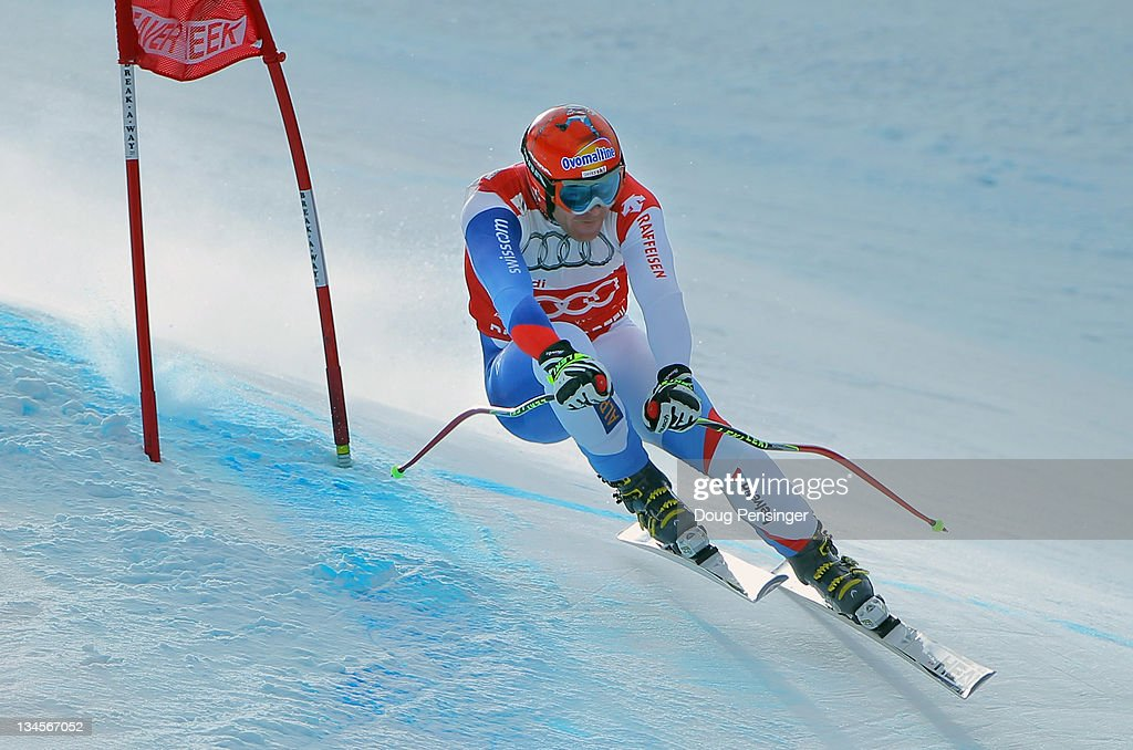 Didier Cuche of Switzerland skis to ninth place in the downhill on The Birds of Prey during the Audi FIS World Cup on December 2, 2011 in Beaver Creek, Colorado. Cuche retained the downhill points leader bib.