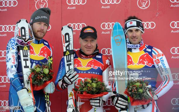 Didier Cuche of Switzerland takes 1st place Bode Miller of the USA takes 2nd place and Adrien Theaux of France takes 3rd place during the Audi FIS...