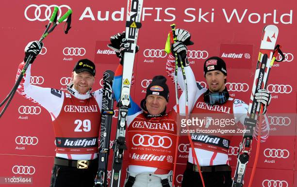 Didier Cuche of Switzerland takes 1st place, Klaus Kroell of Austria takes 2nd place, Joachim Puchner of Austria takes 3rd place during the Audi FIS...