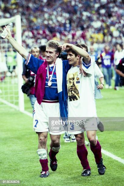 Didier Deschamps and Bixente Lizarazu of France celebrate the victory after the Soccer World Cup Final between Brazil and France on July 12 1998 in...