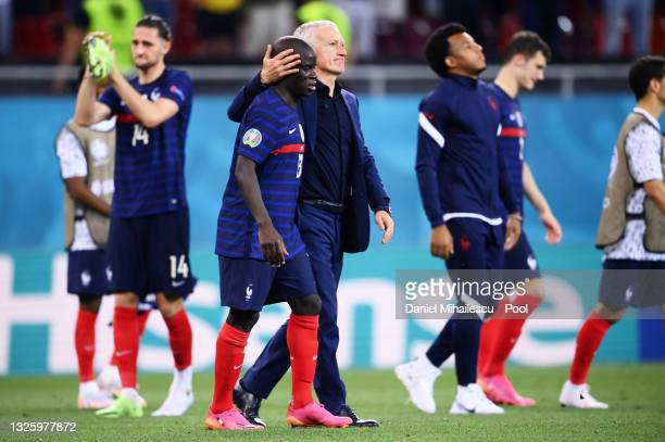 Didier Deschamps, Head Coach of France consoles N'Golo Kante of France after losing in the penalty shoot out in the UEFA Euro 2020 Championship Round...