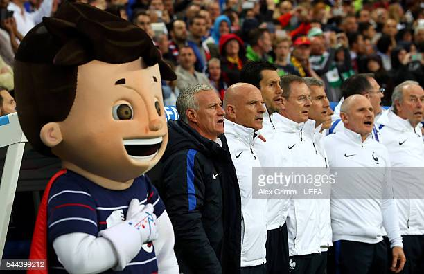 Didier Deschamps manager and France team staffs sing the national anthem with the Euro 2016 mascot Super Victor prior to the UEFA EURO 2016 quarter...