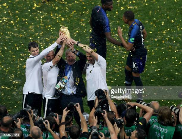 Didier Deschamps Manager of France and hisi staff celebrate with the World Cup Trophy following their sides victory in the 2018 FIFA World Cup Final...