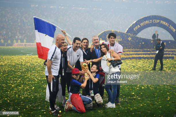 Didier Deschamps Manager of France celebrates victory with family and staff following the 2018 FIFA World Cup Final between France and Croatia at...