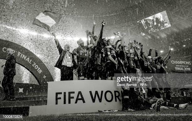Didier Deschamps Manager of France celebrates waving a French flag as Hugo Lloris of France lifts the trophy following his side victory in the 2018...