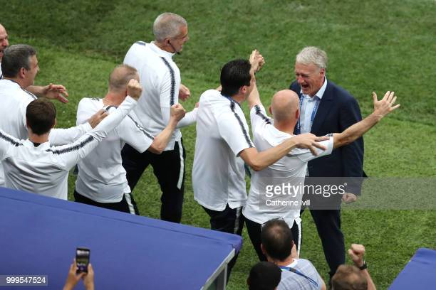Didier Deschamps Manager of France celebrates with his coaching staff during the 2018 FIFA World Cup Final between France and Croatia at Luzhniki...