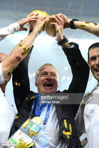 Didier Deschamps Manager of France celebrates with the World Cup Trophy following his sides victory in the 2018 FIFA World Cup Final between France...