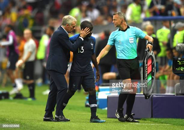 Didier Deschamps Manager of France consoles Ngolo Kante of France after his substitution during the 2018 FIFA World Cup Final between France and...