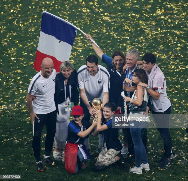 Didier Deschamps Manager of France Guy Stephan France Assistant Coach and France Goalkeeping Coach Franck Raviot celebrate with their families and...