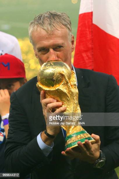 Didier Deschamps Manager of France kisses the FIFA World Cup trophy at the end of of the 2018 FIFA World Cup Russia Final between France and Croatia...